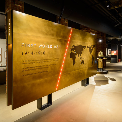 Display and interpretive graphics. Bronze feature displays and signage elements